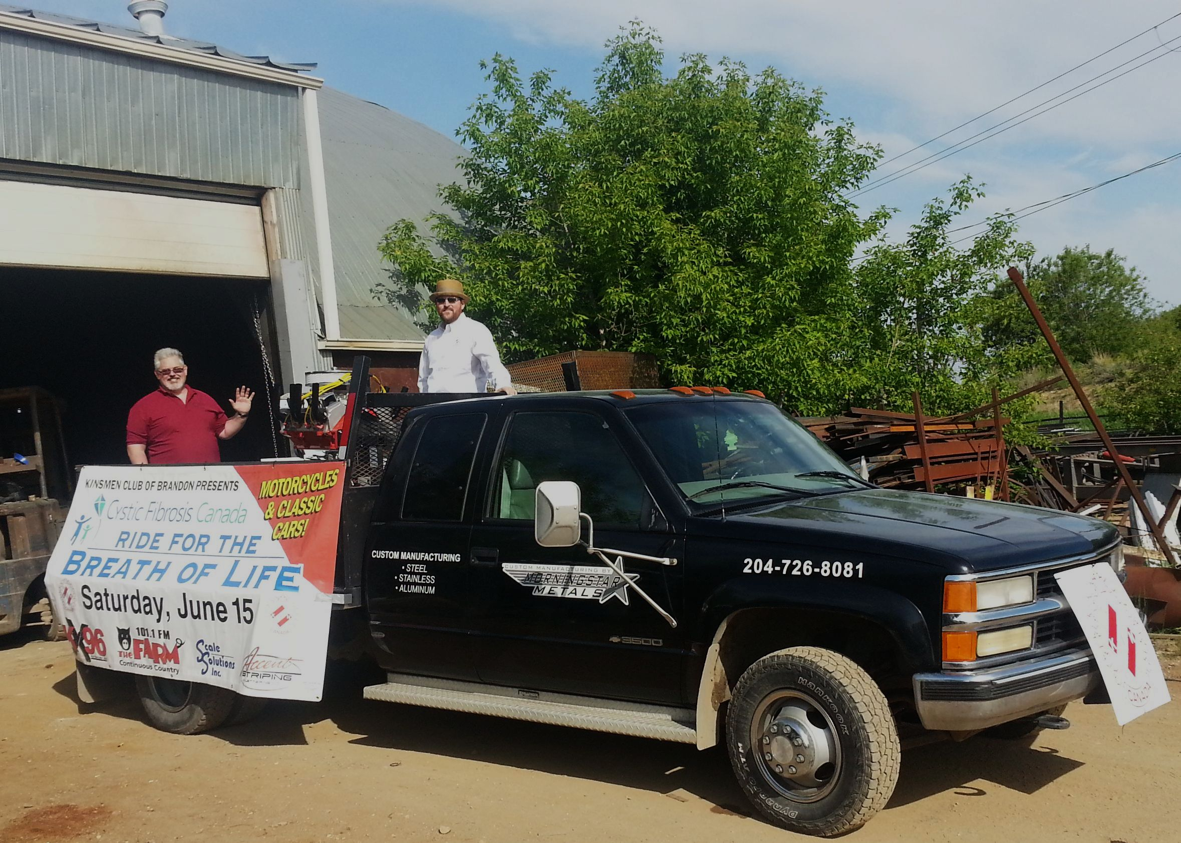 Art Wiebe (L) and Kelly Graham (R) try out the Kinsmen Club of Brandon float for the 2013 Travelers Day Parade