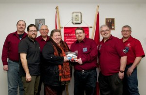 Kinsmen members present kits to Marla Somersall of Samaritan House, February 2014.