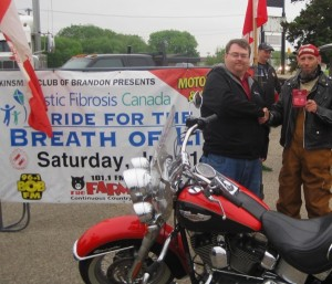 Tony May receives the prize for Show and Shine Best Motorcycle from James Sewell, President, Kinsmen Club of Brandon